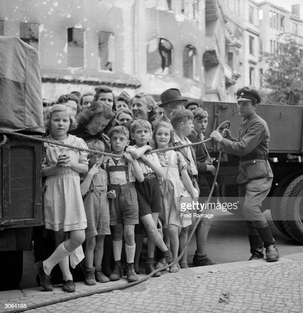 Some of the thousands of German children evacuated from Berlin by the British Army after World War II await a reunion with their friends and family...