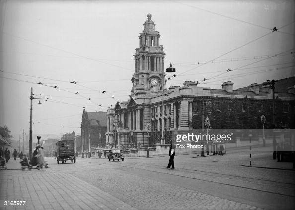 A policeman directing traffic outside the townhall at Stockport