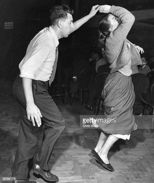 A couple jiving to Humphrey Lyttelton's band at the Jazz Club 100 Oxford Street