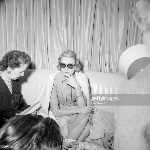 American actress Grace Kelly being interviewed by journalists aboard the 'Constitution' before her wedding to Prince Rainier III of Monaco