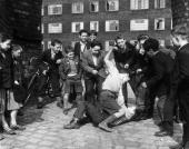 Boys scrambling beside blocks of housing in a deprived area of Liverpool They are members of the Rodney Youth Centre known as 'The Street Corner With...