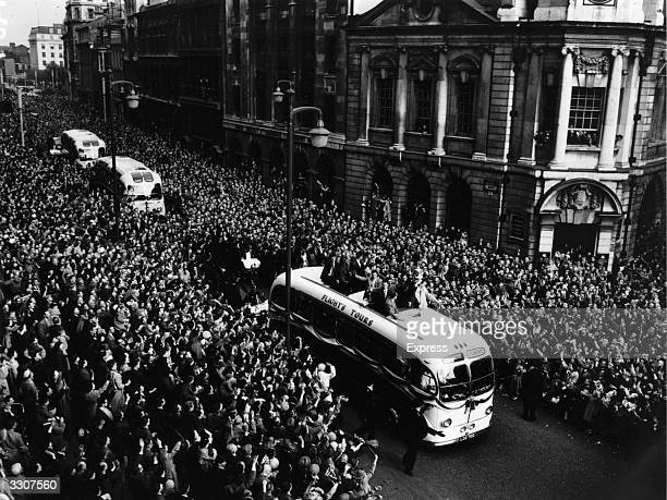 Crowds line the streets of Birmingham cheering the Aston Villa team as they parade the FA Cup trophy from an open top bus after their 21 win over...