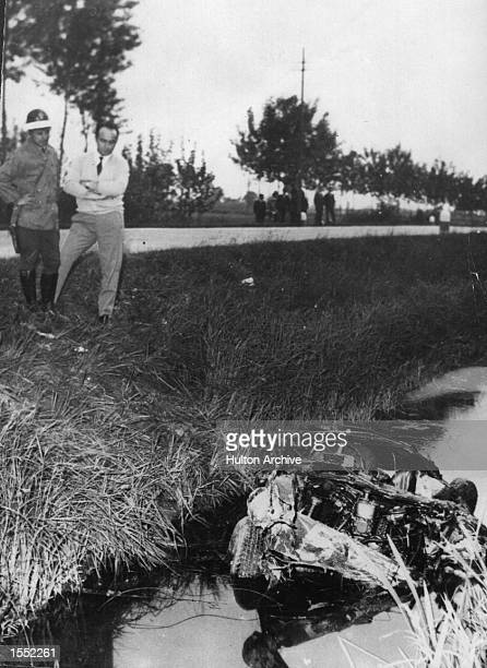 The wreck of the Ferrari driven by Marquis Alfonso De Portage after the crash during the Mille Miglia Mandatory Credit Allsport Hulton/Archive