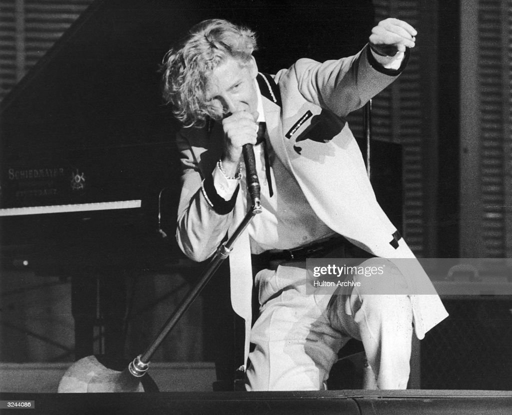 American rock n' roll singer and pianist Jerry Lee Lewis performing in concert in England.