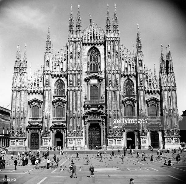 The Gothic facade of the Duomo in the Piazza del Duomo Milan