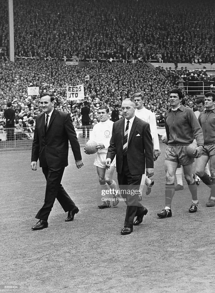 Liverpool Football Club manager Bill Shankly and Leeds United Football Club manager Don Revie lead their teams out at Wembley Stadium London for the...