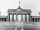 The famous landmark of the Brandenburg Gate stands just behind the Berlin Wall inside Soviet controlled East Berlin