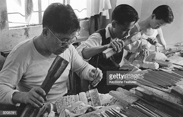 Workers carving ivory figurines at the Ngai Hing ivory factory in Hong Kong
