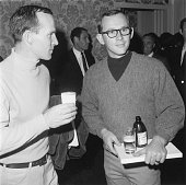 Brothers Dick and Tom Smothers of the American comedy team the Smothers Brothers drink beer at an ABC party for Emmy nominees Beverly Hills Hotel...