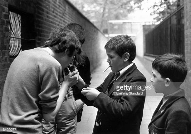 A group of schoolboys from Holland Park School London lighting up some illicit cigarettes