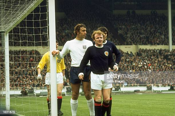 Billy Bremner and Francis Munro of Scotland wait for a cross with Martin Chivers of England during a match at Wembley Stadium in London England won...