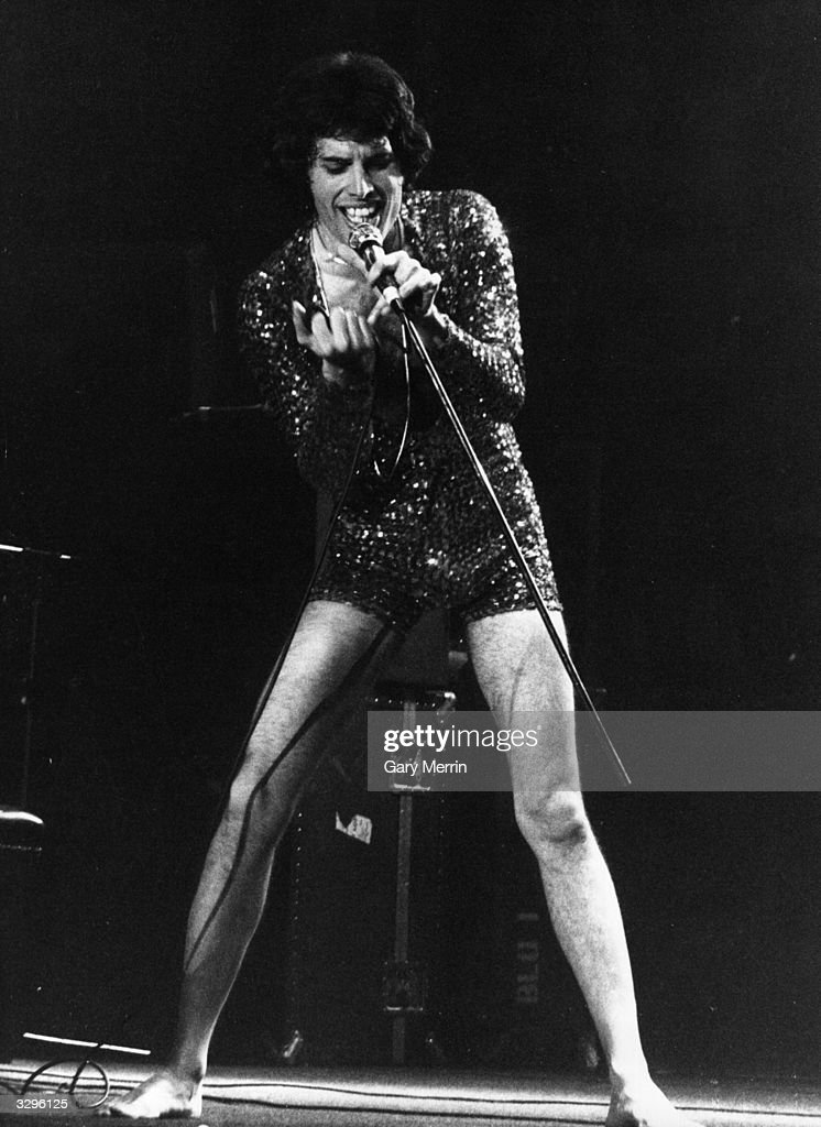 Freddie Mercury (Frederick Bulsara, 1946 - 1991), singer with popular British rock group <a gi-track='captionPersonalityLinkClicked' href=/galleries/search?phrase=Queen+-+Band&family=editorial&specificpeople=221314 ng-click='$event.stopPropagation()'>Queen</a>, on stage with the band at the first of three sell-out nights at London's Wembley Arena, May 1972.