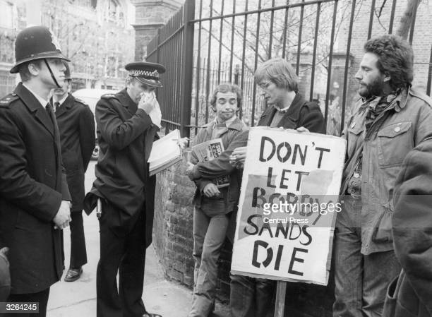 A policeman talking to IRA sympathisers bearing banners on behalf of the hunger striker Bobby Sands during a May Day march at Clerkenwell Green in...