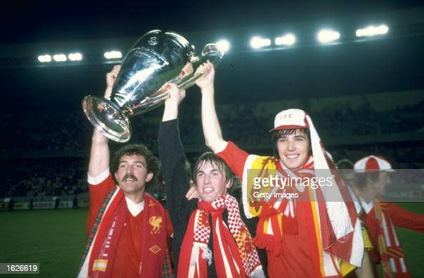 Graeme Souness Kenny Dalglish and Alan Hansen the three Scottish players for Liverpool hold up the European Cup after beating Real Madrid in the...