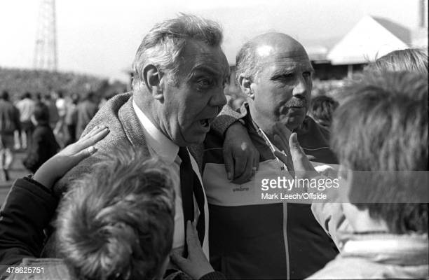 12 May 1984 Football League Division One Notts County v Liverpool FC Liverpool manager Joe Fagan with Ronnie Moran struggle to make their way as the...
