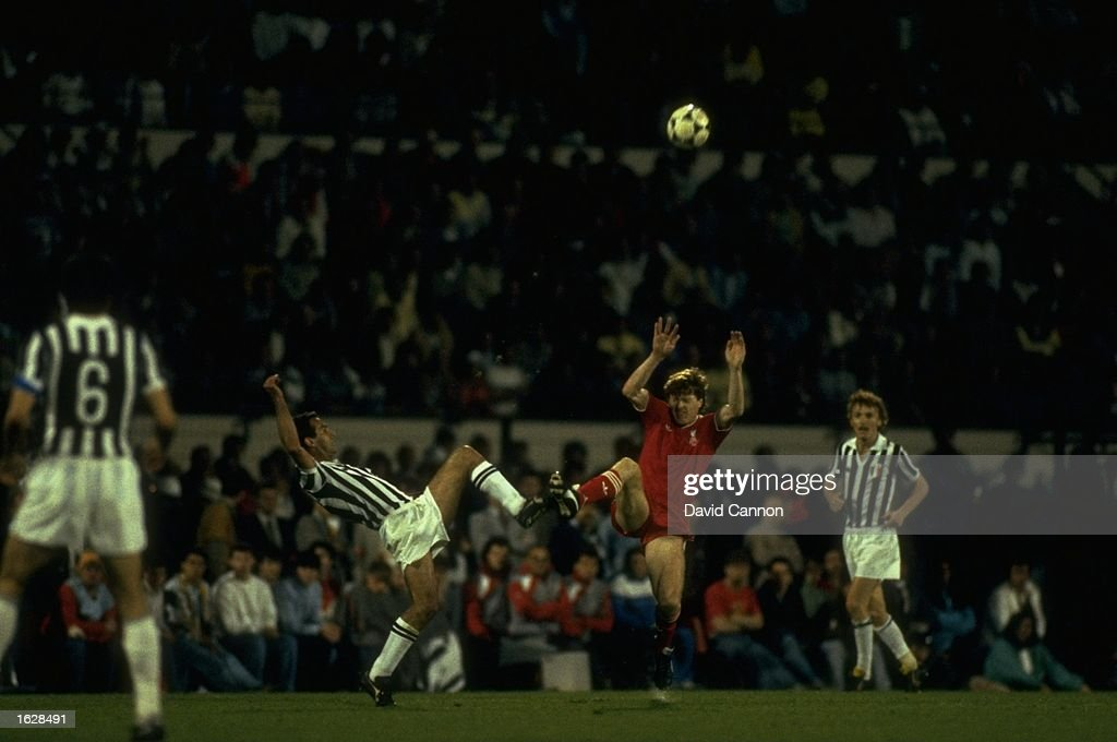Cabrini of Juventus and Steve Nicol of Liverpool kick the ball together during the European Cup Final at the Heysel Stadium in Brussels Juventus won...