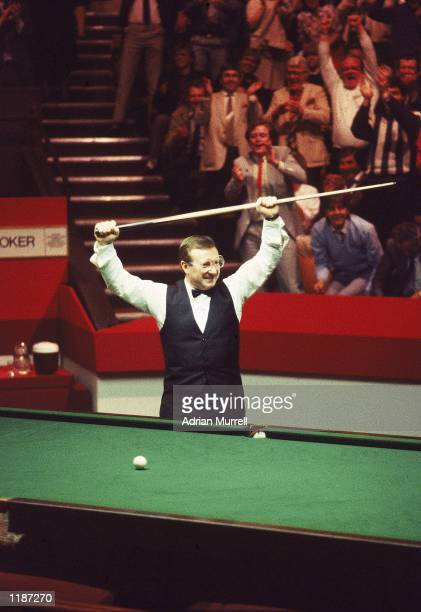 Dennis Taylor of Northern Ireland celebrates victory in the Embassy World Snooker Championship Final at the Crucible Theatre in Sheffield England...