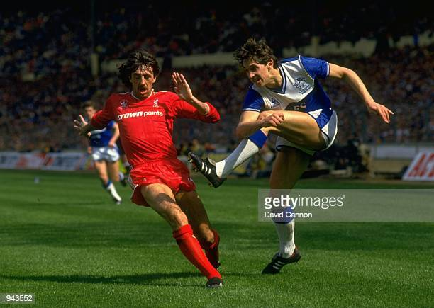 Gary Lineker of Everton shoots past Mark Lawrenson during the FA Cup Final at Wembley Stadium in London Liverpool won the match 31 Mandatory Credit...