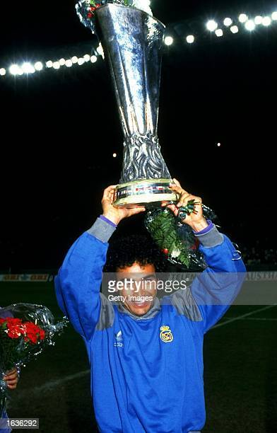 Hugo Sanchez of Real Madrid celebrates with the trophy aloft after winning the UEFA Cup Final Second Leg match against IFC Cologne at the...