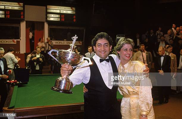 Joe Johnson of England with his wife and the trophy after victory in the Embassy World Snooker Championship Final at the Crucible Theatre in...
