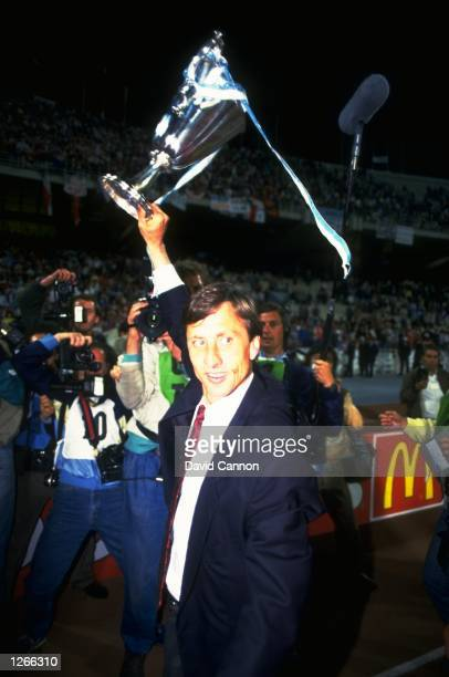 Ajax Coach Johan Cruyff holds the trophy aloft after the European Cup Winners Cup final against Lokomotive Leipzig at the Olympic Stadium in Athens...