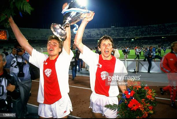 Arnold Muhren and Verlatt of Ajax celebrate with the trophy after the European Cup Winners Cup Final match against Lokomotive Leipzig at the...