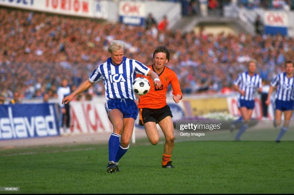 Peter Larsson of IFK Gothenburg controls the ball while Paul Sturrock of Dundee United moves in during the UEFA Cup Final First Leg match at the Nya...