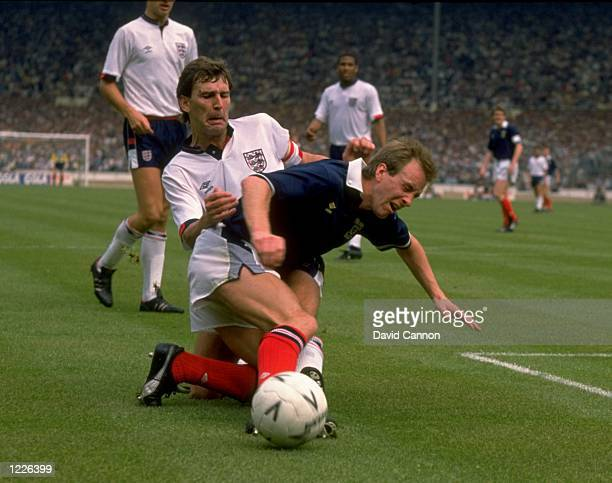 Bryan Robson of England tackles Paul Simpson of Scotland during the Rous Cup match at Wembley Stadium in London England won the match 10 Mandatory...