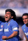 Diego Maradona of Napoli celebrates a goal during an Italian Serie A match against AC Milan at the San Paolo Stadium in Naples Italy Milan won the...