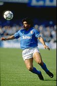 Diego Maradona of Napoli SSC in action during an Italian League match against Milan at the San Paolo Stadium in Naples Italy Milan won the match 32...
