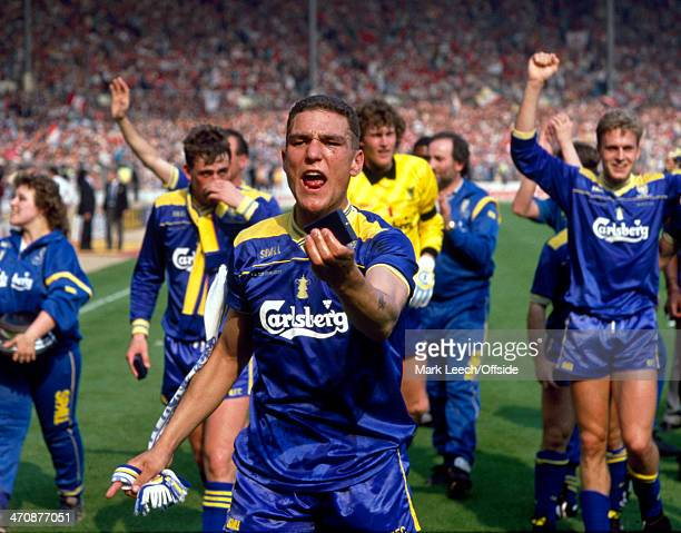 14 May 1988 FA Cup Final Liverpool FC v Wimbledon FC Vinnie Jones of Wimbledon waves his winning medal towards the media as his team cause a big...