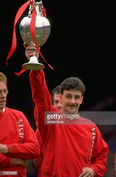 John Aldrige of Liverpool holds the League Champions trophy aloft before the Barclays League Division One match against Southampton at Anfield in...