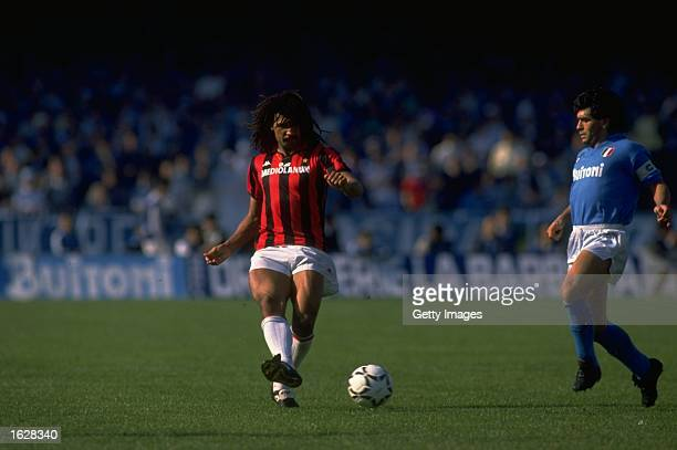 Ruud Gullit of AC Milan passes the ball away from Diego Maradona of Napoli during an Italian Serie A match at the Stadio Sao Paolo in Naples Italy AC...