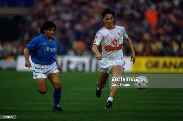 Diego Maradona of Napoli marks Sigurvinnson of Stuttgart during the UEFA Cup Final Second Leg match at the Neckarstadion in Stuttgart Germany Napoli...