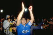 Diego Maradona of Napoli SSC applauds in celebration after the UEFA Cup final Second Leg against Stuttgart at the Neckarstadion in Stuttgart Germany...