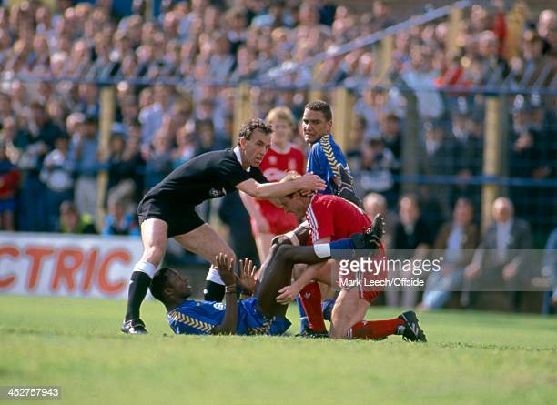 13 May 1989 English Football League Division One Wimbledon v Liverpool FC Referee George Courtney tries to separate John Fashanu of Wimbledon and...