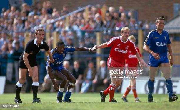 13 May 1989 English Football League Division One Wimbledon v Liverpool FC Referee George Courtney makes peace between John Fashanu of Wimbledon and...