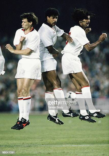 Marco Van Basten Frank Rijkaard and Ruud Gullit of AC Milan on 24 May 1989 jump in the air during the European Cup Final match against Steaua...