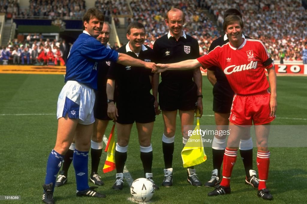 The team Captains Kevin Ratcliffe (left) of Everton and Ronnie Whelan (right) of Liverpool shake hands before the FA Cup final at Wembley Stadium in London. Liverpool won the match 3-2. \ Mandatory Credit: Simon Bruty/Allsport