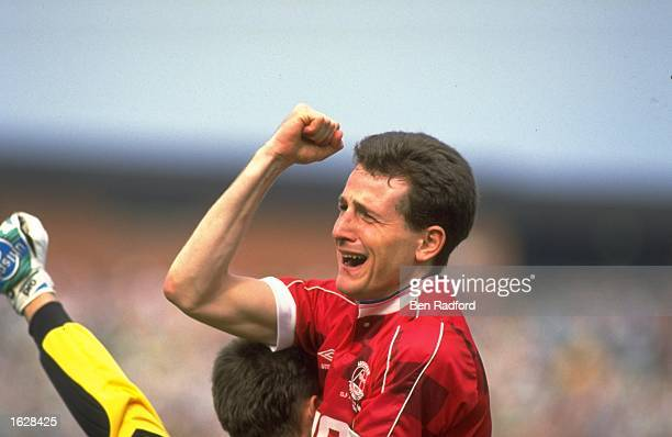 Brian Irvine of Aberdeen celebrates after he scores the winning penalty during the Scottish Cup Final against Celtic at Hampden Park in Glasgow...