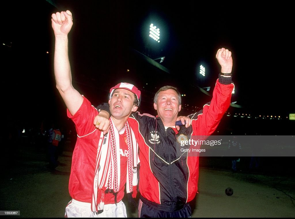 Bryan Robson of Manchester United and Manager Alex Ferguson celebrate after their victory in the FA Cup Final against Crystal Palace at Wembley Stadium in London, England. Manchester United won the match 1-0 after extra time. \ Mandatory Credit: Allsport UK /Allsport