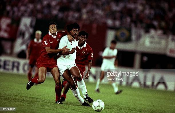 Ricardo of Benfica holds back Frank Rijkaard of AC Milan during the European Cup final in Vienna Austria AC Milan won the match 10 Mandatory Credit...