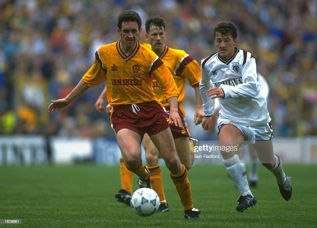 Craig Paterson (left) of Motherwell gets away from Billy McKinley (right) of Dundee during the Scottish Cup final at Hampden Park in Glasgow, Scotland. Motherwell won the match 4-3. \ Mandatory Credit: Ben Radford/Allsport