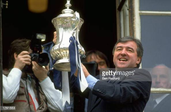 Terry Venables the manager of Tottenham Hotspur holds the trophy aloft during the homecoming after winning the FA Cup Final against Nottingham Forest...