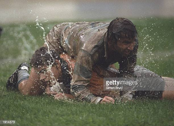 Jason Little of Australia is tackled by Santiago Meson of Argentina during the Rugby Sevens Championships in Hong Kong Mandatory Credit Simon...