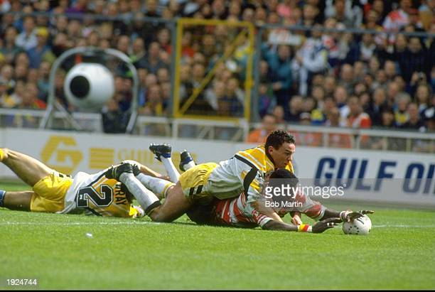 Martin Offiah of Wigan beats a Castleford player to the touch down during the Challenge Cup final at Wembley Stadium in London Wigan won the match...