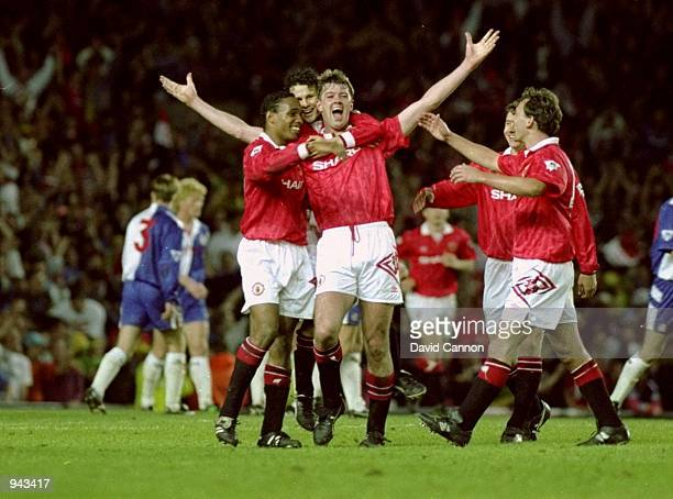 Gary Pallister of Manchester United celebrates his goal against Blackburn Rovers with team mates during the FA Carling Premier League match at Old...