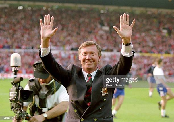 Manchester United Manager Alex Ferguson celebrates his team becoming Premier League Champions after a match against Blackburn Rovers at Old Trafford...