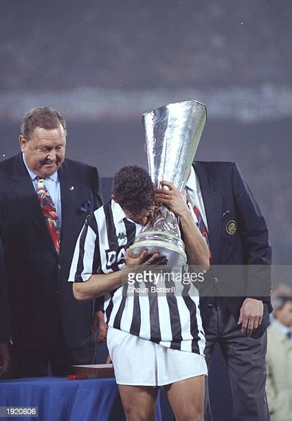 Roberto Baggio of Juventus kisses the cup after his team wins the UEFA Cup final second leg against Borussia Dortmund at the Delle Alpi Stadium in...