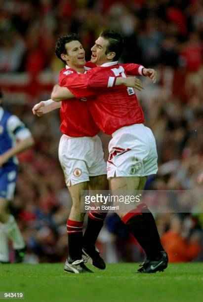 Ryan Giggs of Manchester United celebrates a goal with team mate Eric Cantona during an FA Carling Premier League match against Blackburn Rovers at...